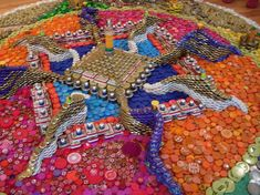 Temporary mandala made with bottle caps, tins, etc, by Bryant Holsenbeck.  Bluesphere: earth art expo