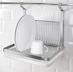 GRUNDTAL Dish Drainer    $26.99  This dish drainer is compatible with IKEA's GRUNDTAL rail system, so it can hang on the wall, drying dishes without taking up any countertop real estate at all — and then fold up when not in use.