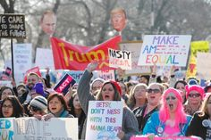 Protesters cheer at the Women's March on January 21, 2017 in Chicago, Illinois. Thousands of demonstrators took to the streets in protest after the inauguration of President Donald Trump.