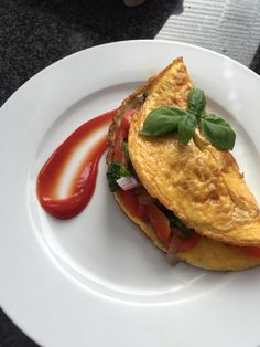 Stuffed omelette with a variety of greens. The greens were first blanched in stock, then pan-fried in a rosemarysauce