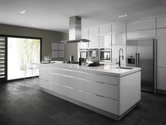 The wall to ceiling glass-design cabinet fronts complete this sleek modern kitchen design.