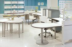 Clara diamond table and wrap around ganged desk.   Many shapes and fun, bright color options with Clara by izzy+