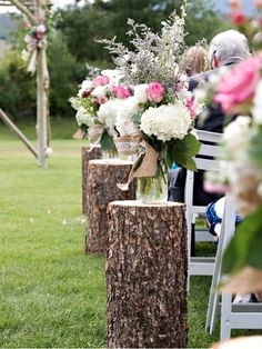 use wood stumps for a rustic wedding theme