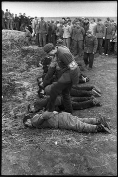 April 5, 1968. Huang Shan cemetery. The photograph shows seven men and one woman being executed by the Red Guard. The photograph was taken in the outskirts of Harbin in the Heilongjiang Province.