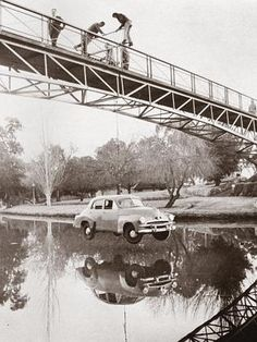 University students hang a FJ Holden motor car from Adelaide University footbridge, as part of a Prosh week stunt in Only wish we had the next photo in this sequence. Adelaide Cbd, Adelaide South Australia, Holden Wagon, Holden Australia, University Of Adelaide, Melbourne Street, City Roller, Old Photos, Vintage Photos