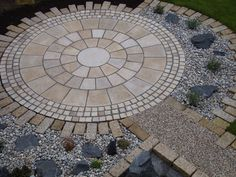 Our Yellow Granite Circle makes a striking feature in this garden!