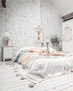 Kind of a different vibe than my usual frenchy farmhouse style, and I'm kinda diggin' it!! Spotted this relaxing, cozy, Scandinavian style stunner on @arlenesharris's feed, and I'm having all the feelings about that exposed brick wall whitewashed so perfectly, those wide plank floors, and the oversized bedding--yummo!! Love finding inspiration from different styles...there's enough room for us all here! . . If you spot a beautiful bedroom, use the hashtag #CottonStemHeartsBedrooms, an...