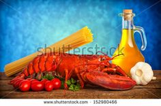 Ingredients of lobster with linguine on wooden table by Antonio Gravante, via Shutterstock