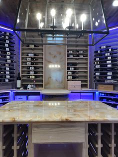 Clean and modern wine room w acrylic and wood wine racks, onyx table top and backsplash, barrel stave ceiling and climate control Just Wine, Wood Wine Racks, Climate Control, Wine Collection, Wine Storage, Wine Cellar, Backsplash, Barrel, Modern Design