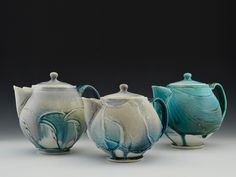 Chris Lively  |  Teapot Trio, to 8 in. (20 cm) in height, porcelain, matte crystalline glaze, fired to cone 6 in an electric kiln, 2016.