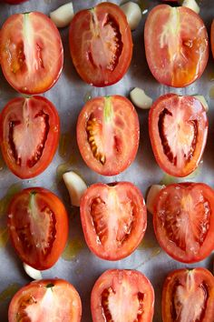 Halved Roma tomatoes with whole garlic cloves drizzled with olive oil and sprinkled with salt. Oven Roasted Tomatoes, Roasted Tomato Soup, Soup Recipes, Vegan Recipes, Cooking Recipes, Roma Tomato Recipes, Homemade Tomato Basil Soup, Tomato Vegetable, Tomatoes