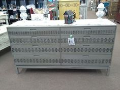 SOLD - This mid century solid wood 8 drawer dresser is painted gray with stenciled details on drawers, distressed and finished in tinted wax. ***** In Booth A8 at Main Street Antique Mall 7260 E Main St (east of Power RD on MAIN STREET) Mesa Az 85207 **** Open 7 days a week 10:00AM-5:30PM **** Call for more information 480 924 1122 **** We Accept cash, debit, VISA, Mastercard, Discover or American Express