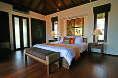 The two-level bedroom villa has one bedroom on each floor. The master bedroom on the upper floor, shown here, offers sea views.