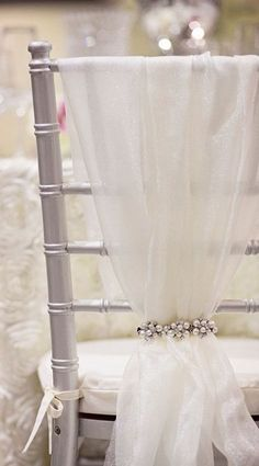 Soft chiffon tied with vintage accessories makes for the perfect wedding chair look