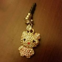 Hello Kitty phone charm Jeweled Hello Kitty phone charm.  It plugs into your phone where you would plug in headphones.  It's super cute! Accessories