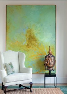 Using an oversized painting in watery hues..decorating with art