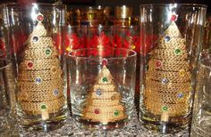 Culver jeweled Christmas tree glasses.  I believe this pattern to be the oldest of the Xmas tree bejeweled glasses.  The tall glasses have the script Culver signature while the short glasses do not.