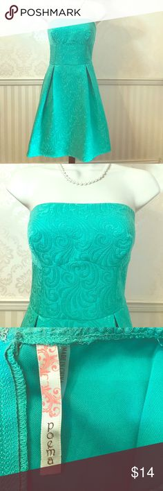 Poema Turquoise Strapless Brocade Dress Poema strapless dress in excellent condition. Lovely turquoise color. Floral brocade print. Flattering fit and flare style. Perfect for day or night! Fully lined. 100% polyester. Size M. Poema Dresses Strapless