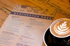 Manchester Press  Melbourne, Australia         DESIGNED BY THE HUNGRY WORKSHOP.  An initial crisp, clean pass of Melbourne bagelry Manchester Press' one-page menu followed by a second, slightly off register pass with a mutilated plate speaks to the cafe's heritage as a former letterpress shop.