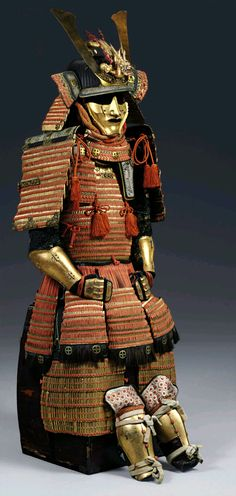 Gold-lacquer armor with Shimazu family crests. Edo period (19th century) The armor laced in bright orange and decorated with gilt-metal Shimazu family crests  and a gold-lacquer dragon maedate, the lowest lame trimmed in boar's fur.