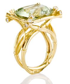 Ward Kelvin's cocktail ring is made in 18-karat yellow gold with a green amethyst