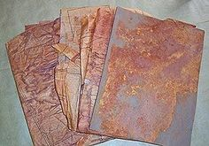 Here's some paper that has been created by pressing it between sheets of rusted metal.        <3 JH