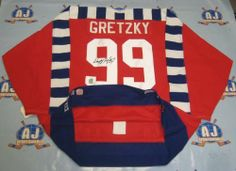 WAYNE GRETZKY 1992 NHL All Star Game SIGNED PRO-JERSEY LE #/199 . $1158.05. This is an official licensed SIGNED Wayne Gretzky All Star jersey. The jersey is brand new with all of the lettering and numbering professionally sewn on. The player has beautifully signed the number. To protect your investment, a Certificate Of Authenticity and tamper evident hologram from A.J. Sports World is included with your purchase.