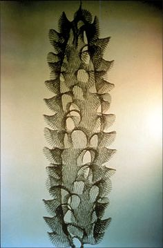 Ruth Asawa. 1959. Untitled, S039. Hanging five spiraling columns of open windows. Crocheted monel wire