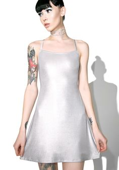 Current Mood Helios Slip Dress will blind 'em with yr burnin' ambition, babe. This ultra luxxx sleeveless slip dress features a slinky metallic silver construction that glides over yer bod, slim fit, and thin crossed back straps.