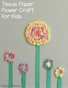 Spring Craft for Kids: Colorful Tissue Paper Flowers- Perfect for decorating your home or classroom walls! Also make a great way to decorate a homemade card for Mother's Day!