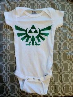 Zelda Triforce Hylian Crest Onesie by LunaLovegoodIsOk on Etsy, $12.00