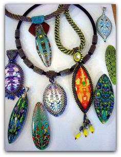 Some of Bridget Derc's 'lizard tail' pendants. She embellishes her cabochons with intricate beadwork.