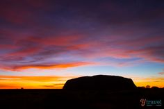 See a sunrise silhouette at Uluru in Australia - bucket list tick!