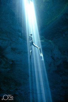 Freediving Photography - Freediving the Cenotes of the Yucatan Peninsula, Mexico. Photo taken on one breath by Eusebio Saenz de Santamaria.