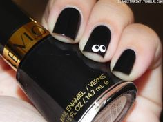 Start with a coat of black, then use two different-sized dotting tools (like a Q-tip and a thin water-based Sharpie) for an easy accent nail.