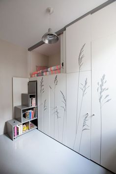 The shelves also become the stairs to the lofted bed, and they have the added benefit of extra seating. --- See how this tiny 86 square foot room was renovated into an apartment with everything you need