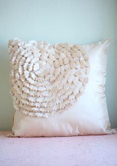 "Brisbane Applique Throw Pillow 32.99 at shopruche.com. A champagne colored throw pillow features a satin-like sheen, and little fabric appliques that make a floral design. A hidden zipper on the side provides for an easy exchange of pillows.  Approx. 16""L x 16""W"