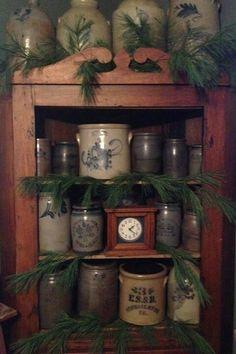 Vintage pottery / crocks displayed around clock Antique Crocks, Old Crocks, Primitive Antiques, Primitive Decor, Primitive Homes, Primitive Country, Stoneware Crocks, Antique Stoneware, Prim Decor