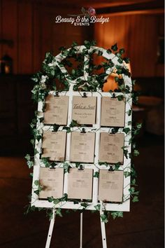 Seating chart made of an old white window pane, covered in ivy and brown paper with table assignments. Rustic Seating Charts, Seating Chart Wedding, Table Seating Chart, Indoor Wedding, Fall Wedding, Our Wedding, Wedding Colors, Wedding Flowers, Tiffany Wedding
