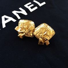 """Authentic vintage CHANEL clip earrings Vintage 1970s gold tone CHANEL earrings. Guaranteed authentic. Clip on. A little over 1"""" square. Basket weave with ribbon bow pattern. Each back is stamped CHANEL. Gorgeous, in mint condition. No flaws--I don't believe they've ever been worn; to me they look new. No box, no bag. Priced to sell! CHANEL Jewelry Earrings"""