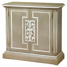 Display a vase of fresh blooms in your foyer or stow table linens in the dining room with this grey and beige cabinet, showcasing front molding and 2 doors o...