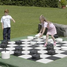 """Giant outdoor checkers game - saw this idea at the beach.  """"Board"""" was made with concrete squares.  Plan to have this at Ellijay house - just need cheaper checkers.  :)"""