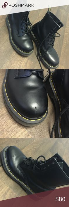 DR. Martens boots Small scuff on front row of right boot- besides that great condition! Black boots with yellow lining on them Dr. Martens Shoes Combat & Moto Boots