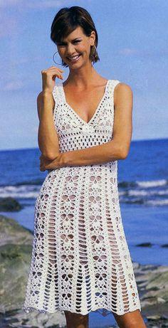 vestido de encaje blanco muy hermoso con un ganchillo