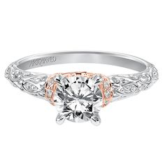 "<p> 	ArtCarved ""Rhonda"" diamond semi-mount engagement ring in 14k white and rose gold with scrolled openwork design. Diamonds equal .11 carat total weight. <br /> 	Available by special order only (please allow approximately 6 weeks for arrival).<br /> 	<br /> 	<i>Photo shown with a center diamond to demonstrate the complete look of the ring.</i> <strong>Center sold separately.</strong><br /> 	<br /> 	This ArtCarved ring is also available for special order in 14K yellow gold, 18K white or…"