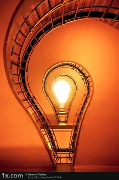 I love the Light-Bulb effect created by the well of this staircase!
