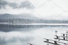 Tourist at winter mountain lake by Sergey Furtaev on @creativemarket