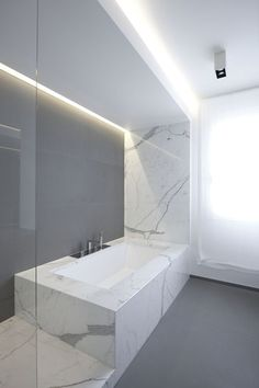 Bathroom in white marble . The Z House by EXiT architetti associati. Photo by Silvia Longhi.