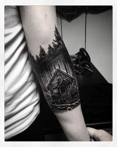 Black Ink Wooden House In Forest Tattoo On Arm Sleeve Forest Tattoo Sleeve, Wolf Tattoo Sleeve, Forest Tattoos, Sleeve Tattoos For Women, Arm Tattoos For Guys, Nature Tattoos, Trendy Tattoos, Arm Band Tattoo, New Tattoos