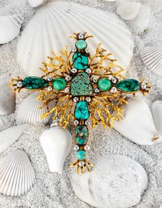 """Neptune's Cross"" brooch made of turquoise, malachite, cultured black pearl and 18K gold."